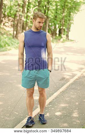 Handsome Sportsman In Sportswear Outdoors. Active Sportsman Training Outdoor. Sportsman Living Healt