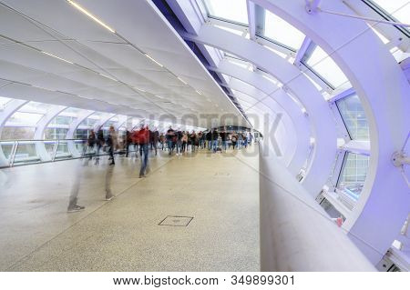 Hamburg, Germany, February 08, 2020: People Are Walking Through The Modern Glass Transition In The E