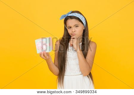 Serious About Holiday Gift. Serious Child Hold Present Box. Little Girl Think With Serious Face. Gif