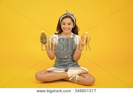 Buy Diet Food. Happy Little Child Hold Bottles With Diet Food. Small Girl Enjoy Natural Diet. Feel N