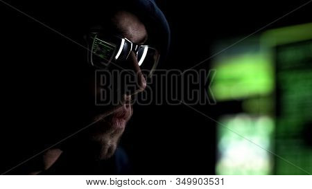 Programmer Intently Looking At Monitor Checking Data, Reflection In Glasses