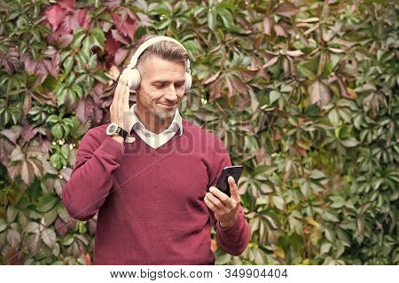 Phone Keeps Him Organized And On-the-go. Happy Man Talk On Mobile Phone Using Wireless Technology. H