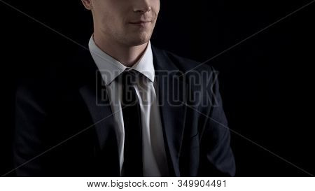 Man In Suit Smirking, Isolated On Black Background, Unfair Business Concept