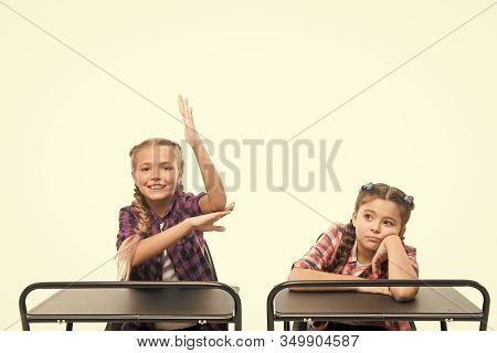 Working Hard On Their Knowledge. Adorable Small Schoolchildren Passing Knowledge Test At School Desk