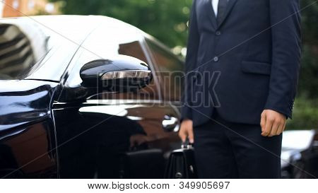 Premium Class Driver Standing Near Luxury Car, Work For Refugees, Service