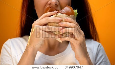 Woman Eagerly Eating Tasty Cheeseburger, Bad Eating Habits, Unhealthy Snack
