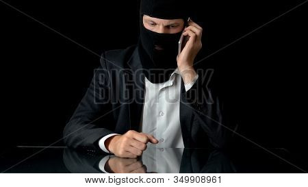 Murderer In Mask Talking On Smartphone With Crime Partner, Contract Murder, Gun