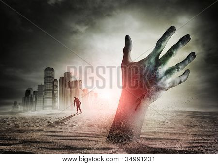 Zombie Rising. A hand rising from the ground!