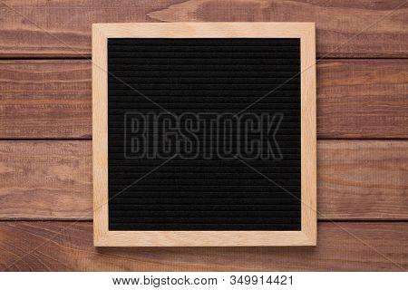 Empty Black Letterboard On Wood Background. Design Mockup