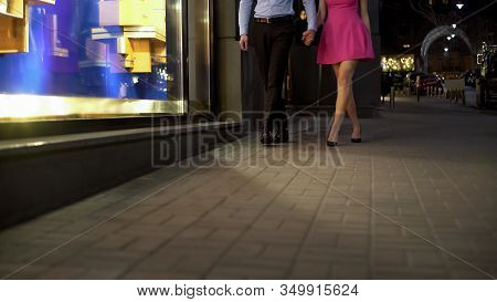 Young Couple In Love Going Home Late At Night After Successful Date, Stroll