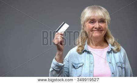 Satisfied Elderly Lady Bank Customer Showing Card Financial Program For Retirees