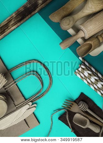 Eco Natural Kitchen Utensils, Paper Bag, Bamboo Cutlery On Green Background, Sustainable Lifestyle C