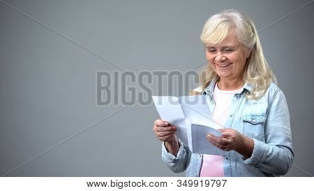 Aged Retiree Lady Reading Letter From Children Receiving Good News Loan Approval