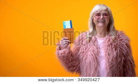 Positive Retiree Lady Showing Passport And Tickets, Visa Service, Travel Agency