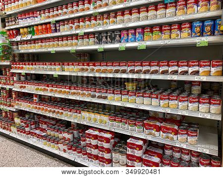Orlando, Fl/usa-2/6/20: The Campbells Soup Aisle At A Publix Grocery Store With A Variety Of Campbel
