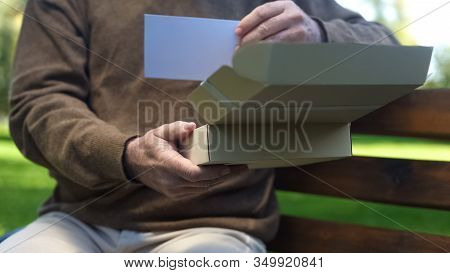 Old Man Opening Carton Box And Looking Photo, Past Memories, Nostalgia, Archive