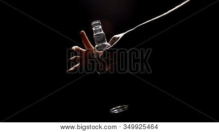 Alcoholic Hand Taking Vodka From Darkness, Descend To Bottom, Misery Life