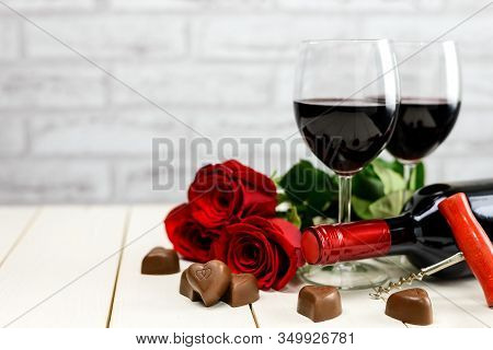 A Glasses Of Wine, Wine Bottle, Roses And Chocolate Hearts