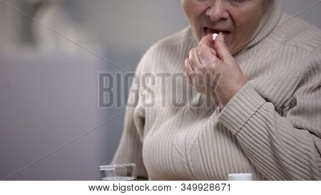 Crying Aged Woman Taking Pills, Suffering From Incurable Disease, Hospital
