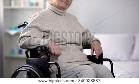 Disabled Elderly Woman Sitting In Wheelchair In Nursing Home, Social Security