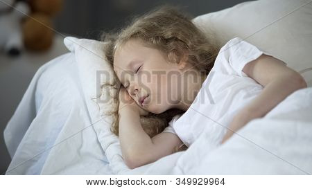 Blond Little Girl Sleeping In Comfortable Bed At Home, Calm Rest For Good Health