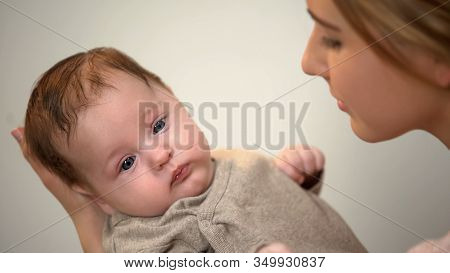 Beautiful Lady Holding Little Adorable Child In Arms, Skin-to-skin Contact