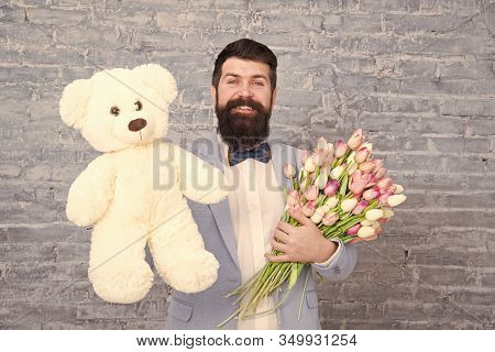 Macho Getting Ready Romantic Date. Waiting For Darling. Man Well Groomed Wear Tuxedo Bow Tie Hold Fl