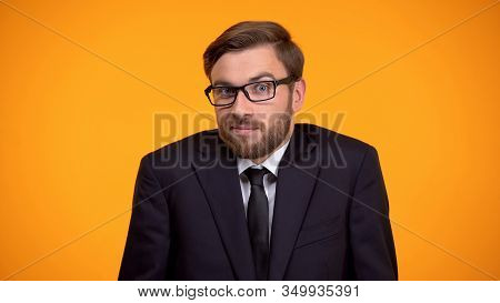 Puzzled Businessman Shrugging Shoulders, Trying To Make Hard Decision, Choice