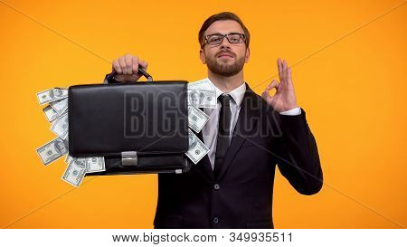 Male Showing Briefcase With Money And Doing Ok Gesture, Payday Lending Service