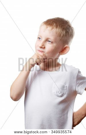 Child Is Pondering An Important Decision, Little Boy In White T-shirt Is Pondering Over The Task, Ph