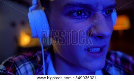 Emotional Teenager Playing Video Game Night, Awkward Age, Face Mimics Close-up