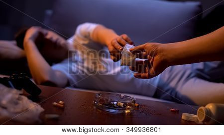 Drug Dealer Hand Giving Cocaine To Narcotic Addicted Teenager, Harmful Effect