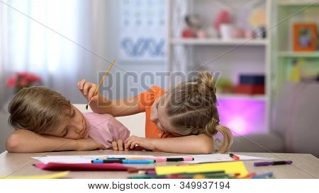 Playful Female Child Painting Sleeping Brothers Face, Family Joke, Fools Day