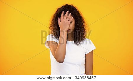 Discontent Biracial Lady Gesturing Face Palm On Camera Against Yellow Background