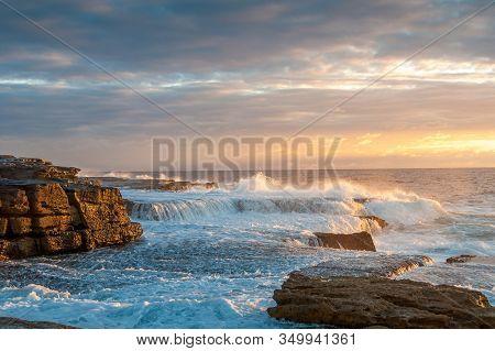 Ocean Coastline Scene With Waves Crushing Over Rocks At Sunrise. Sunset, Sunrise Seascape Nature Bac