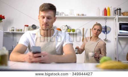 Handsome Man Typing Message In Phone, Jealous Wife Peeping, Cheating In Marriage