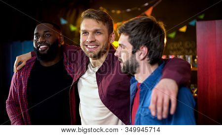 Cheerful Multiracial Friends Hugging, Celebrating Bachelor Party In Bar, Leisure