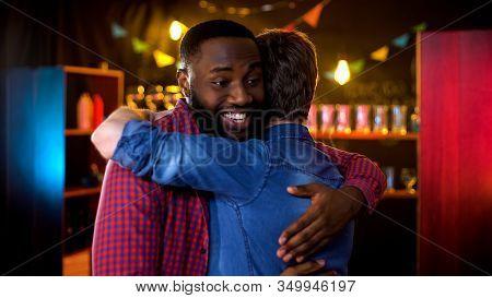 College Buddies Meeting In Pub And Hugging, Greeting Gesture, Friendship