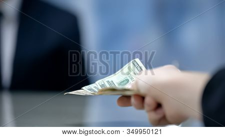 Client Paying Money To Hotel Administrator, Check-in At Reception, Closeup