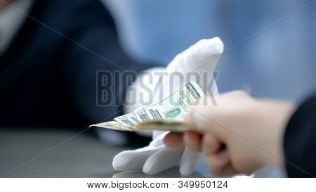 Customer Paying Dollar Banknotes To Receptionist, Check-in At Hotel, Close Up