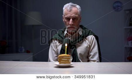 Sad Granddad Celebrating Birthday Alone With Piece Of Cake, Forgotten By Family