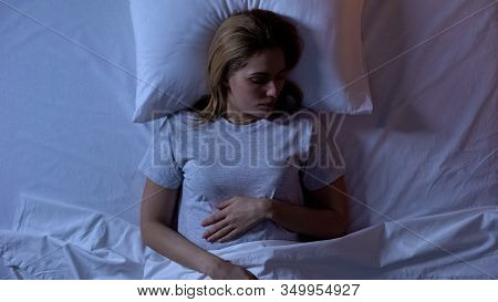 Young Woman Peacefully Sleeping In Comfortable Bed, Sleeping Quality, Top-view