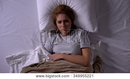 Lady Feeling Unwell Lying In Bed Covered With Blankets, Menstrual Pain, Topview