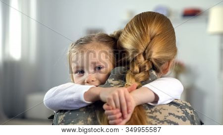 Little Daughter Hugging Soldier Mother In Camouflage Uniform, War Homecoming