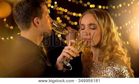 Happy Young Couple Drinking Champagne Brotherhood, Couple Having Fun At Party