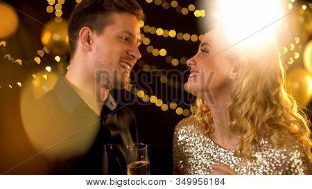 Cheerful Man And Woman Celebrating New Year At Luxury Night Club, Flirting