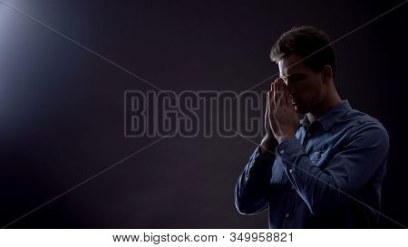 Faithful Male Praying To God, Asking For Blessing And Forgiveness, Belief