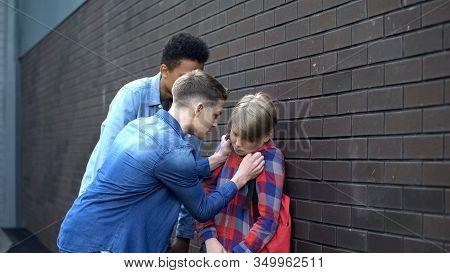 Cruel Students Pushing Boy To Wall, Bullying In Backyard, Physical Intimidation
