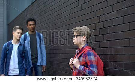 Classmates Mocking Lonely Nerd In Backyard, School Bullying, Intimidation