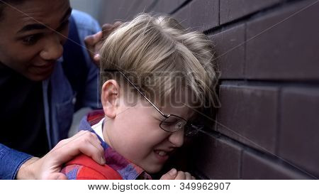 Closeup Of Bullied Student In Broken Eyeglasses, Black Boy Intimidating Nerd